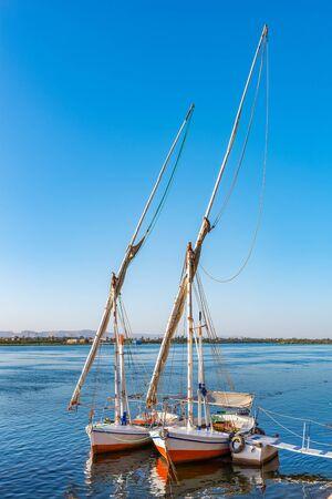 Two moored sailboats