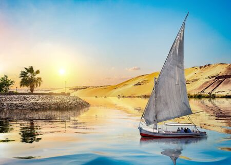 Sunset and sailboat in Aswan