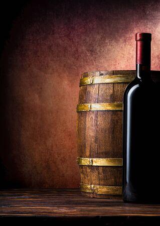 Bottle and barrel on burgundy