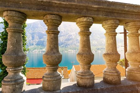 Columns and landscape in Perast