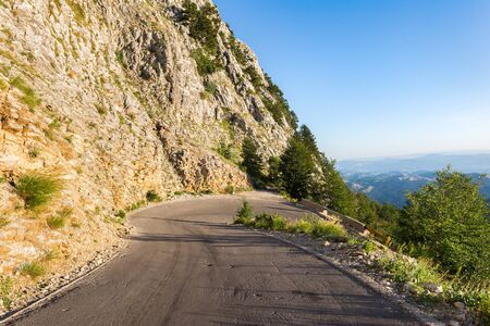 Turn of the road in mountains of Montenegro at sunrise Imagens
