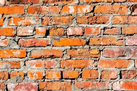 Wall of old red brick close up