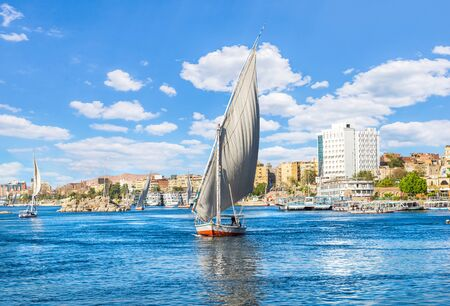 Sailboats on river Nile in Aswan at sunny day