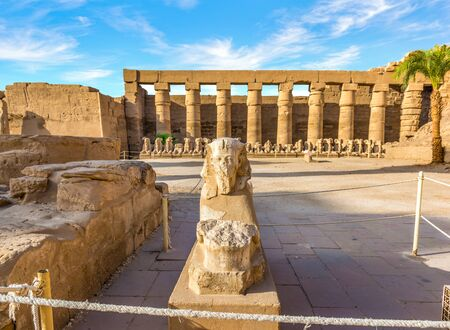 Ruined statue in Karnak background. Reklamní fotografie