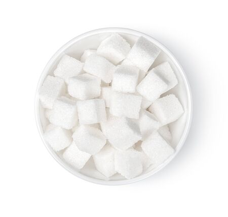 Sugar cubes in bowl with white background.