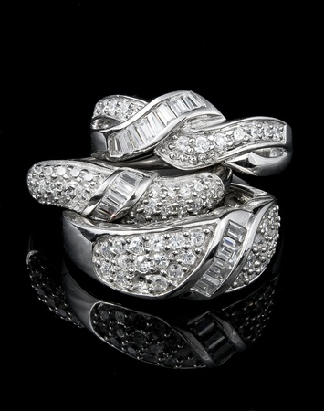three rings on black background Stock Photo - 10275725