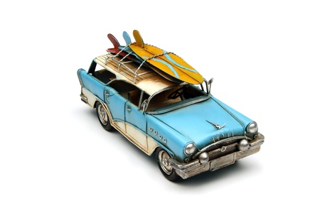 toy car with surfboard on white background photo