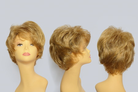 mannequin head: Hair wig over the white plastic mannequin head isolated over the solid background set of three foreshortenings Stock Photo