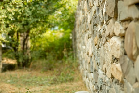 Old vintage stone wal with perspective view and blurred background Stock Photo