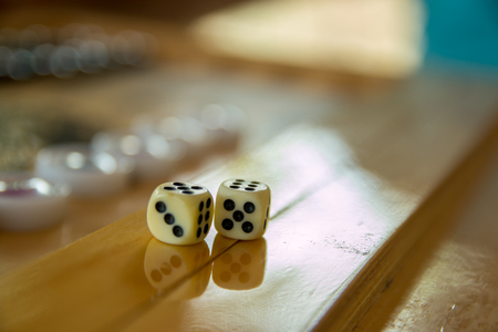 Dices for backgammon. Back gammon table game close up shot.