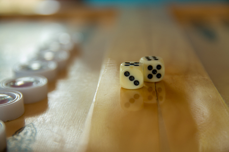 doubling: Dices for backgammon. Back gammon table game close up shot.