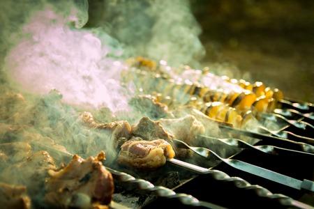 Kebab barbeque with smoke and close up shot.