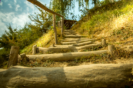 Wood Stair way on grass to hill Stock Photo