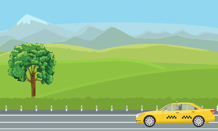 A yellow taxi car passing by a gorgeous green landscape.