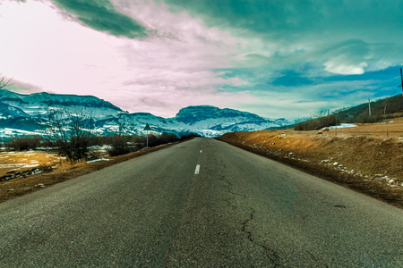 Empty Road to the great mountain with snowy peak. Stock Photo