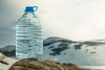 Big Water bottle with snowy mountain peak background.