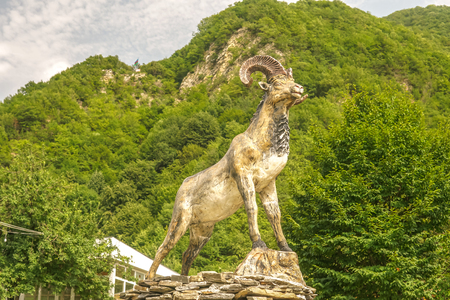 Ram statue with mountain landscape
