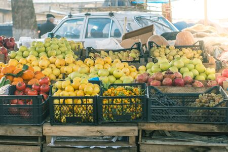 Fruit market at town. Stack of fruits, apples pomegranates, pears, grapes etc. for sale. Stok Fotoğraf
