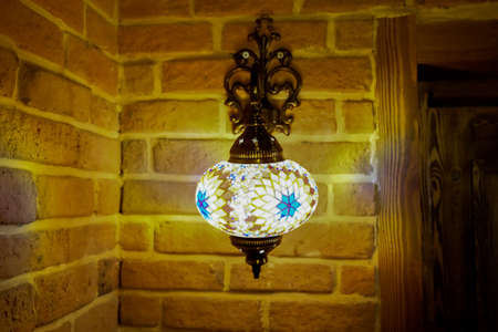 Vintage wall lamp with eastern ornates on it. 写真素材