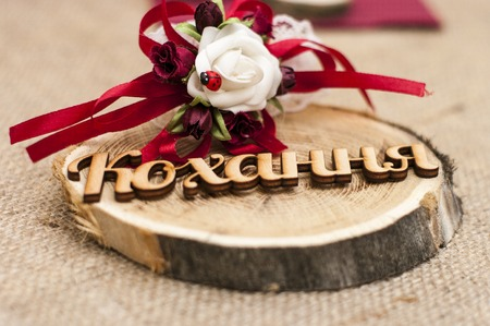 Wedding ceremony. A wooden word LOVE for the couple. With handmade flower and ladybug. Stock Photo