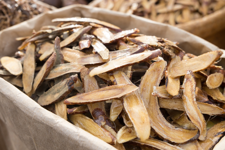 Licorice herbal medicine in wooden chopped and sliced on the table Foto de archivo
