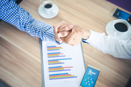 Top View Two Businessman Shaking Hands or Arm Wrestling, cooperative and teamwork concept,corporate life style,Cooperation initiative achievement