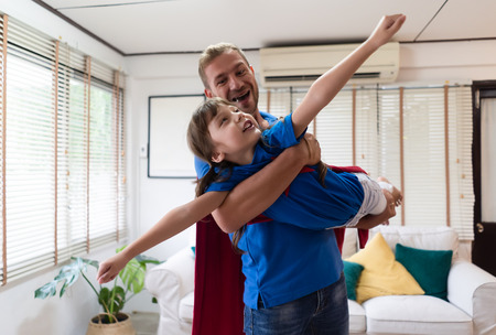 Happy loving family!Father and daughter playing at home at the day time. Fathers day concept.