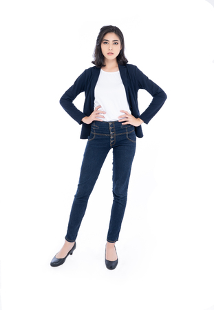 Portrait of attractive young Asian woman standing with hands on waist isolated on white background.