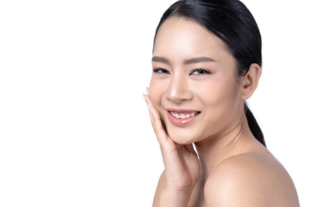 Side view of beautiful smiling Asian woman with beauty skin healthy face close up  isolated on white background.  Cosmetology ,beauty and spa . Girl washes and cleans her face. 스톡 콘텐츠