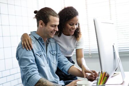 Creative young couple working on Desktop Computer from home office with planning new business ideas. Business People and technology, Working Home office Concept.