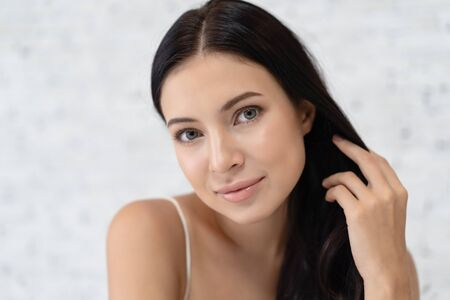 Closeup portrait of natural beautiful woman with blue eyes and looking at camera, sensual fresh happy face, positive emotions. Positive human emotion facial expression feelings, attitude, perception.