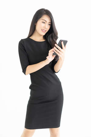Portrait of young Asian businesswoman using mobile phone isolated over white background.Technology, connection, communication, social media concept