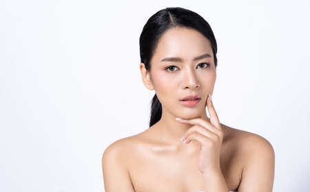 Portrait of beautiful young Asian woman healthy skin natural makeup and clean fresh skin isolated on white. Beautiful Spa Woman Smiling. Cosmetology, Youth and Skin Care Concept