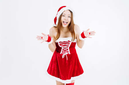 Portrait of excited young Asian woman standing in Christmas dress isolated over white background, Wow and surprised concept.