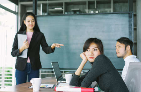 Bored Asian businesswoman at a meeting in modern office with her colleagues. Concept of exhausted businesspeople bored. 版權商用圖片 - 162362198