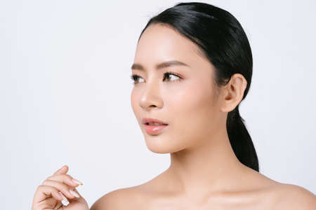 Close-Up Portait of young beautiful Asian woman with natural makeup and looking away isolated over white background. Face care, Facial treatment, beauty and spa, Skincare and Cosmetology concept.