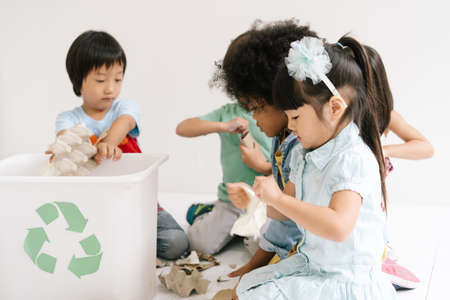 Diversity Children learning biology recycle environment, waste separation in classroom at kindergarten. Education, Recycling and Ecology protection concept.