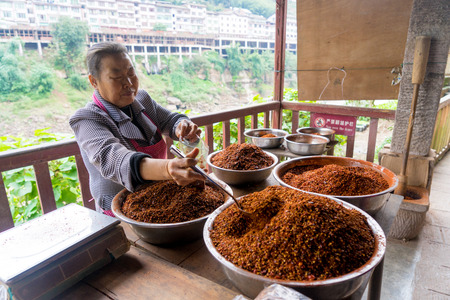 stilted: selling chili powder at ancient town shop