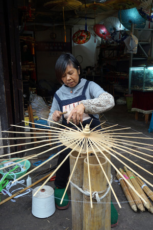 Artisan making traditional Chinese umbrella Editorial