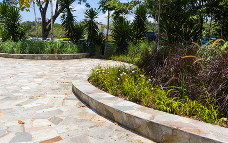 retaining: retaining wall made of natural stone in a botanical garden