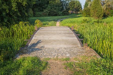 old wooden bridge in the park. Belarus.