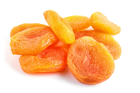 Pile of dried apricots isolated on white background. close up.