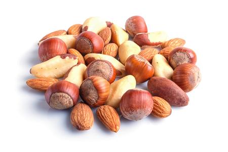 Piles of various nuts  isolated on white background. hazelnut, brazil nut, almond, pumpkin seeds, cashew.  close up. Stok Fotoğraf