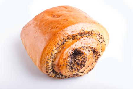 One bun with poppy seeds isolated on white Zdjęcie Seryjne