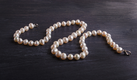 Caramel colored pearl beads on a black