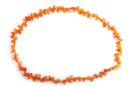 Orange amber beads isolated on white Archivio Fotografico