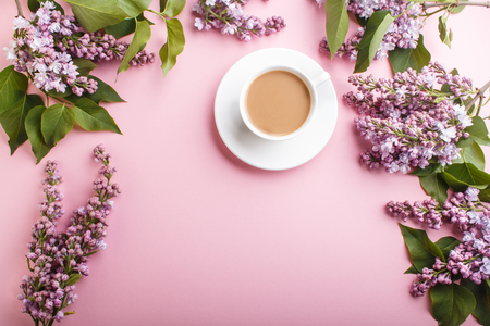 Purple lilac flowers and a cup of coffee on pastel pink Reklamní fotografie - 124156262