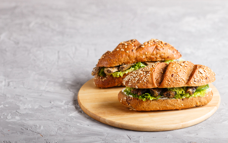 Sprats sandwiches with lettuce and cream cheese on wooden board on a gray concrete Reklamní fotografie - 124156251