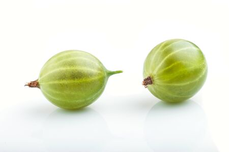 Two ripe green gooseberries isolated on white background. side view, close up. Reklamní fotografie
