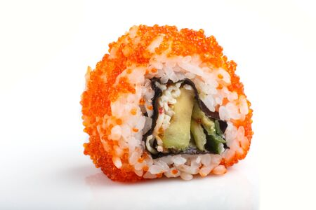 Japanese maki sushi rolls with flying fish roe isolated on white background. Side view, close up, selective focus. 写真素材